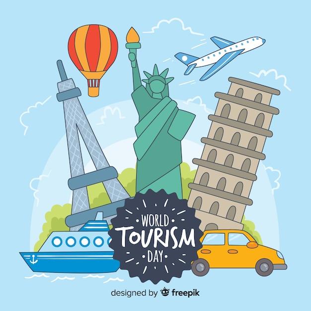 Dia de turismo do mundo desenhado de mão com marcos Vetor grátis