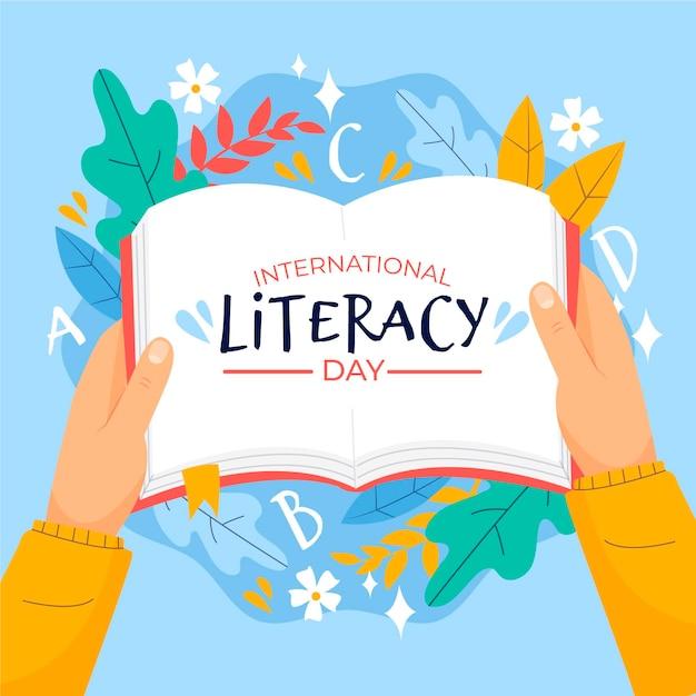 Dia internacional da alfabetização com livro aberto Vetor grátis