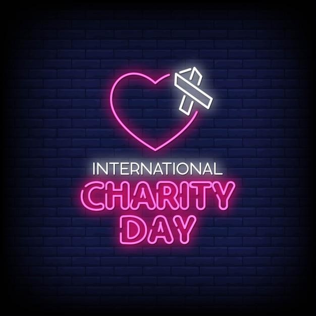 Dia internacional da caridade com sinais néon estilo texto Vetor Premium
