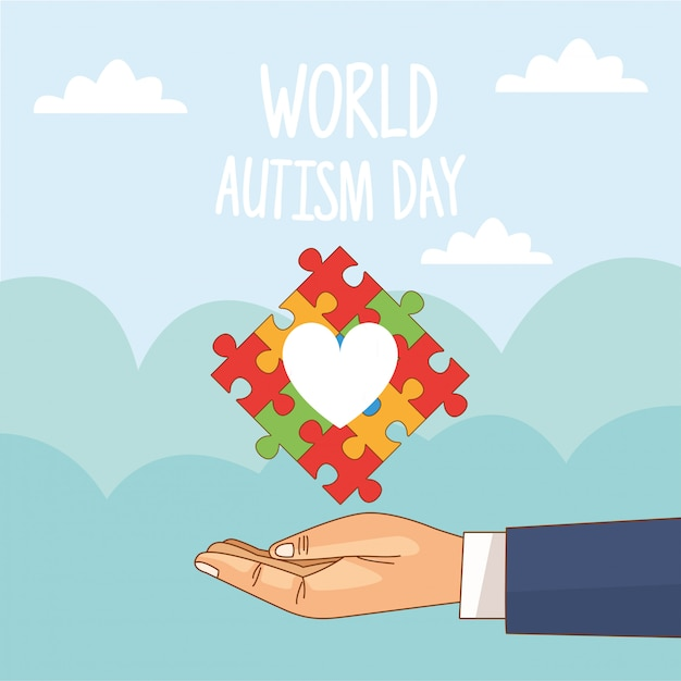 Dia mundial do autismo com mão levantando quebra-cabeça coração Vetor Premium