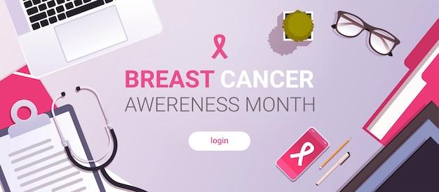 Dia mundial do câncer ícone fita rosa consciência de mama prevenção conceito médico local de trabalho desktop com material de escritório vista de ângulo superior cópia espaço horizontal Vetor Premium