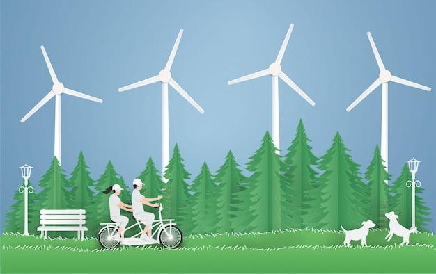 Dia mundial do meio ambiente e dia da terra eco, casal andando de bicicleta Vetor Premium