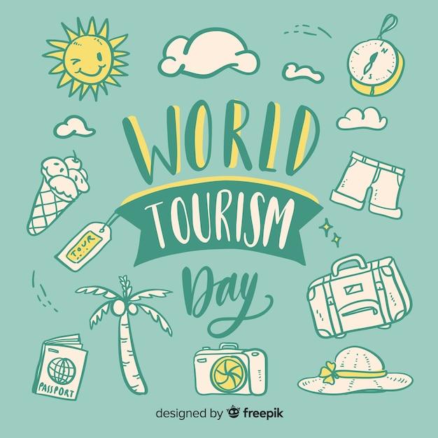 Dia mundial do turismo com objetos de viagens letras Vetor grátis