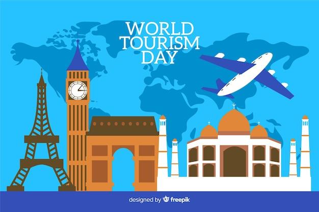 Dia mundial do turismo plana com mapa-múndi no fundo Vetor grátis