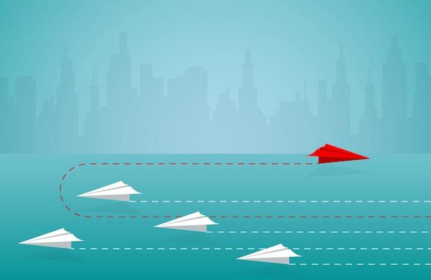Direção em mudança do plano de papel vermelho do branco. nova ideia. conceito de negócio diferente. coragem para arriscar. liderança. vetor de desenhos animados de ilustração Vetor Premium