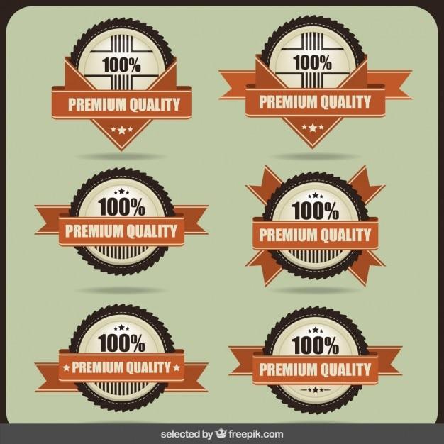 Distintivos 100 por cento de qualidade premium Vetor grátis