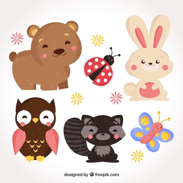 Diversão conjunto de animais sorrisos com design plano Vetor grátis