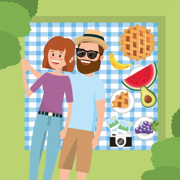 Diversão mulher e homem casal na toalha da mesa Vetor Premium
