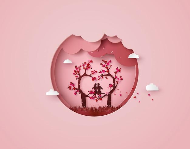 Dois apaixonados debaixo de uma árvore de amor Vetor Premium