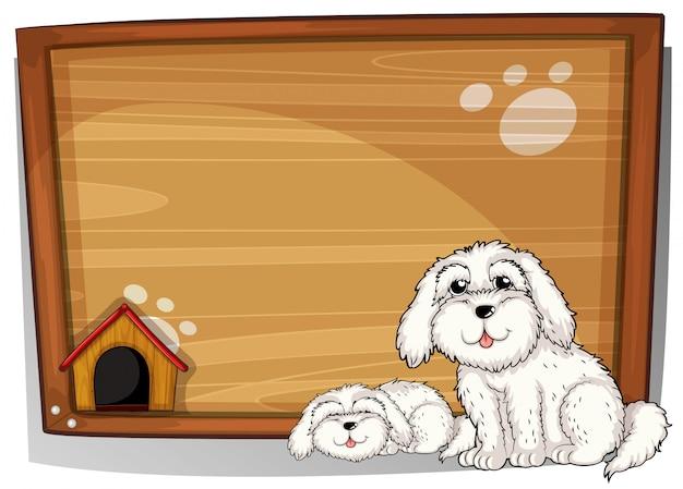 Dois cães brancos na frente de uma placa de madeira Vetor grátis