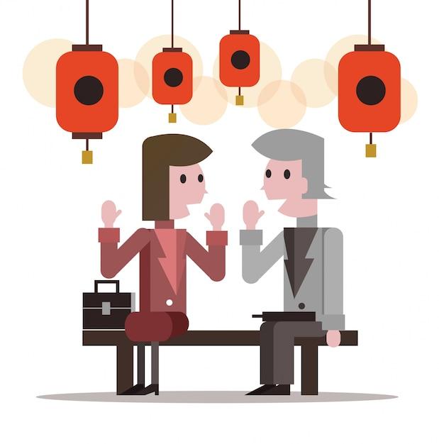 Dois empresários falando no festival da lanterna. design de personagem plano. ilustração vetorial Vetor Premium