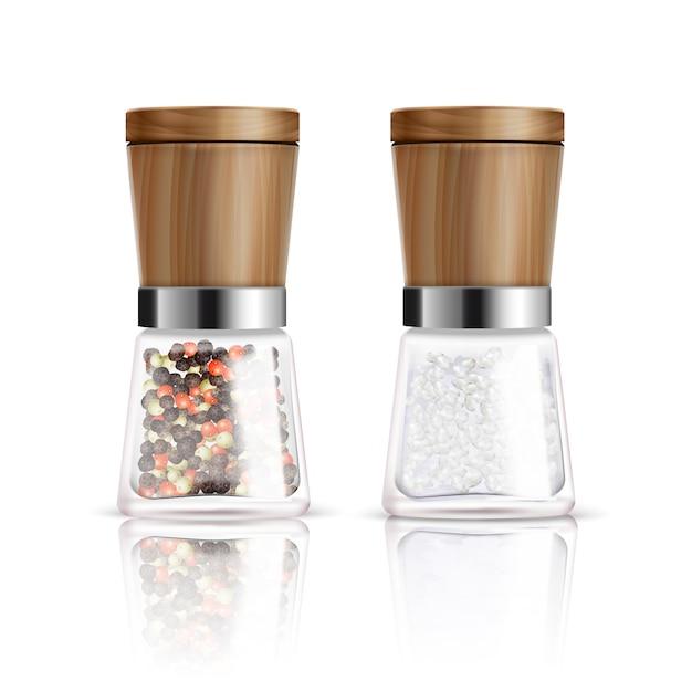 Dois isolado realista sal e pimenta moinho composição com recipiente de vidro e ilustração vetorial de capa de madeira Vetor grátis