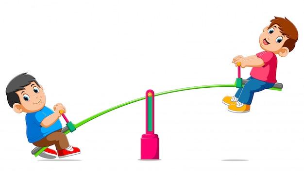 Dois meninos brincando na gangorra Vetor Premium
