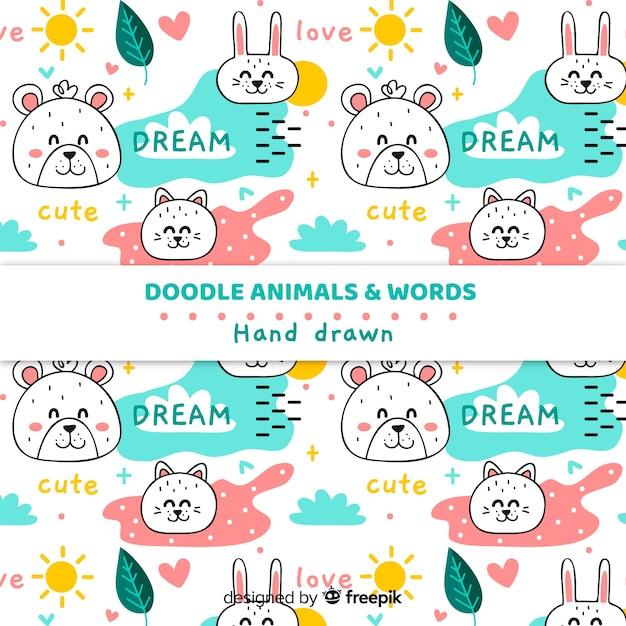 Doodle animais e palavras padrão Vetor grátis