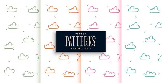 Doodle bonito estilo nuvens conjunto de padrões de quatro Vetor grátis
