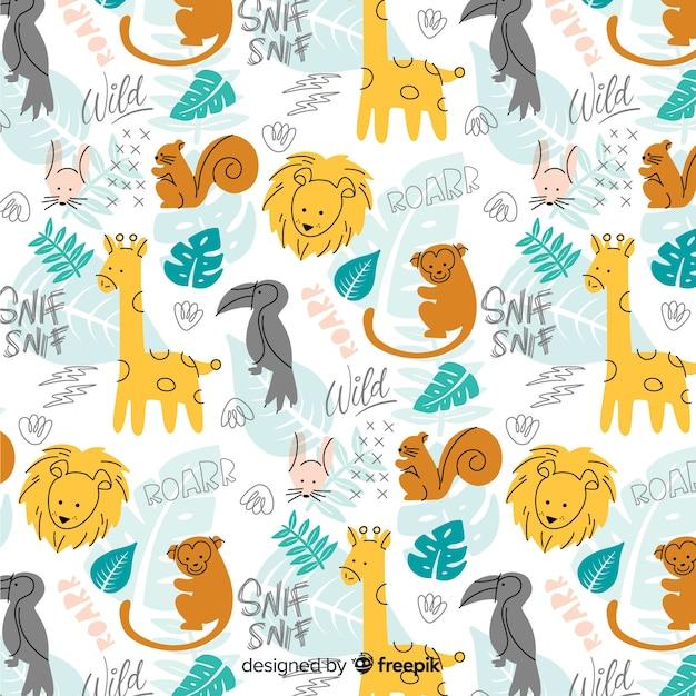 Doodle colorido animais selvagens e padrão de palavras Vetor grátis