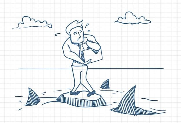 Doodle de homem de negócios permanente na rocha com tubarões em torno do conceito de perigo e crise Vetor Premium