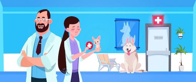 Doutores veterinários sobre cães na medicina do veterinário da sala de espera da clínica e no conceito do cuidado Vetor Premium