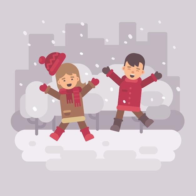Duas crianças felizes pulando em uma cidade de inverno nevado Vetor Premium