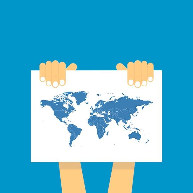 Duas mão segura uma mesa na qual o mapa azul do mundo é representado. Vetor Premium