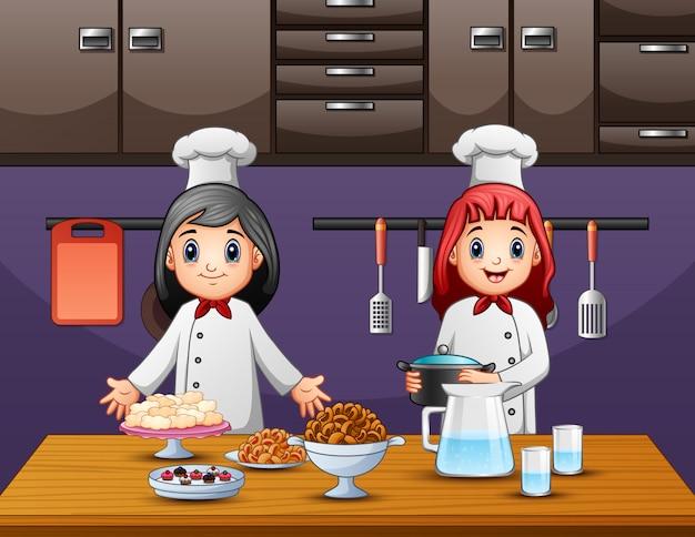 Duas mulheres chef preparando comida na cozinha Vetor Premium