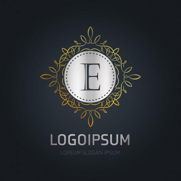 E emblema ornamental Vetor grátis