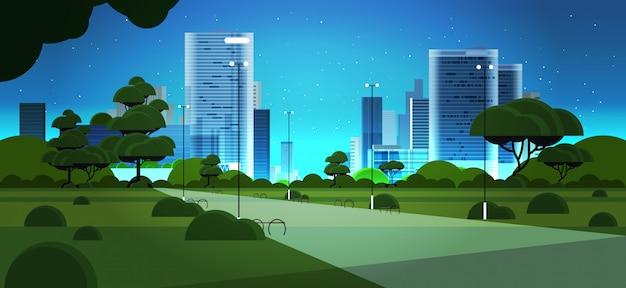 Edifícios do skyskraper do horizonte urbano da cidade parque noite e céu azul escuro com fundo de paisagem urbana de estrelas Vetor Premium