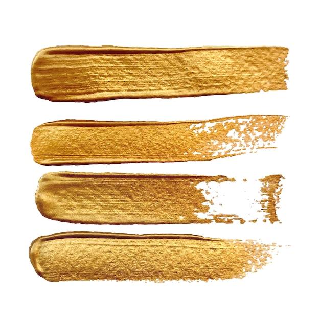 Efeito de traçados de pincel ouro isolado Vetor Premium