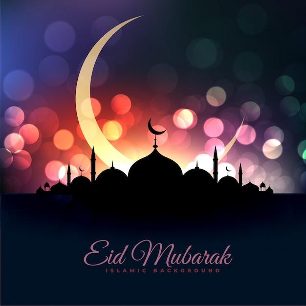 Eid al fitar linda mesquita e lua bokeh saudação Vetor grátis