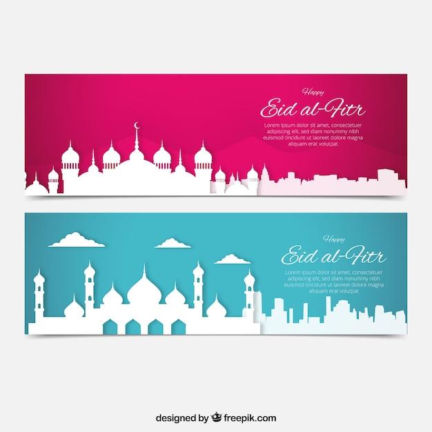Eid al-fitr bandeiras de silhuetas cidade branca Vetor grátis