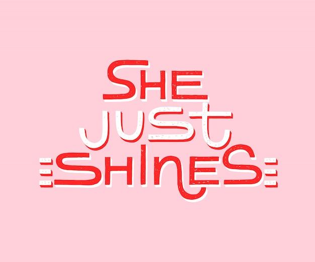 Ela apenas brilha - citação moderna inspiradora caligrafia feminina. Vetor Premium