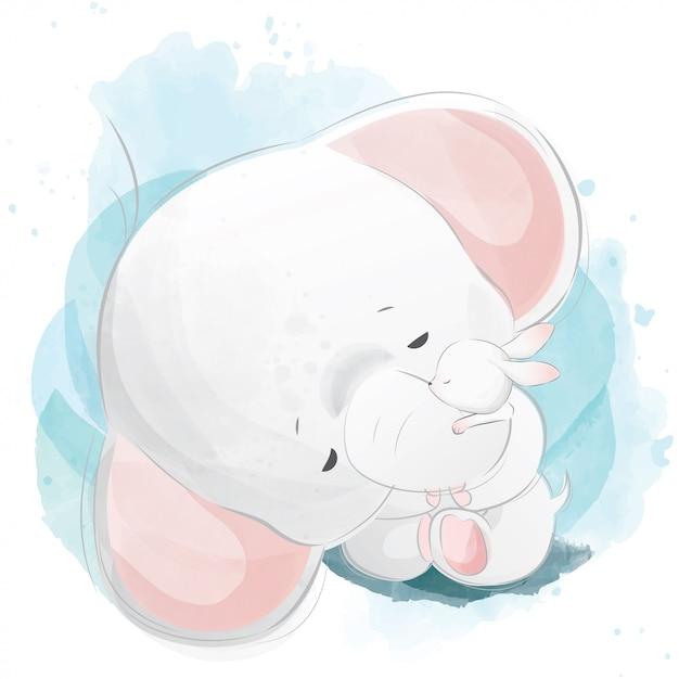Elefante bebê abraçando o coelho Vetor Premium