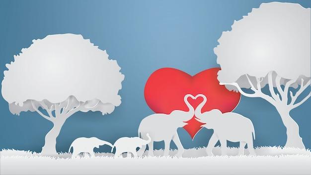 Elefantes mostram amor na grama cinza com fundo de coração, vetor de estilo de artesanato de papel Vetor Premium
