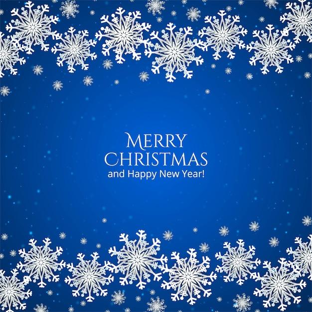 Elegante fundo azul de natal com flocos de neve Vetor grátis
