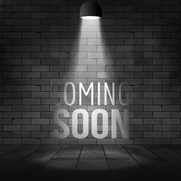 Em breve mensagem iluminada com projetor de luz. parede de tijolos e palco realistas Vetor Premium