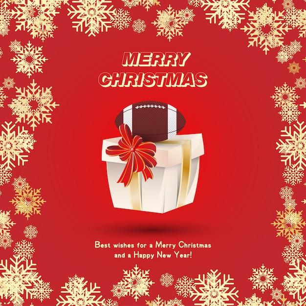 Embalagem de presente com uma bola de futebol americano e fitas de ouro e um laço vermelho no fundo dos flocos de neve. cartão festivo de natal e ano novo Vetor Premium