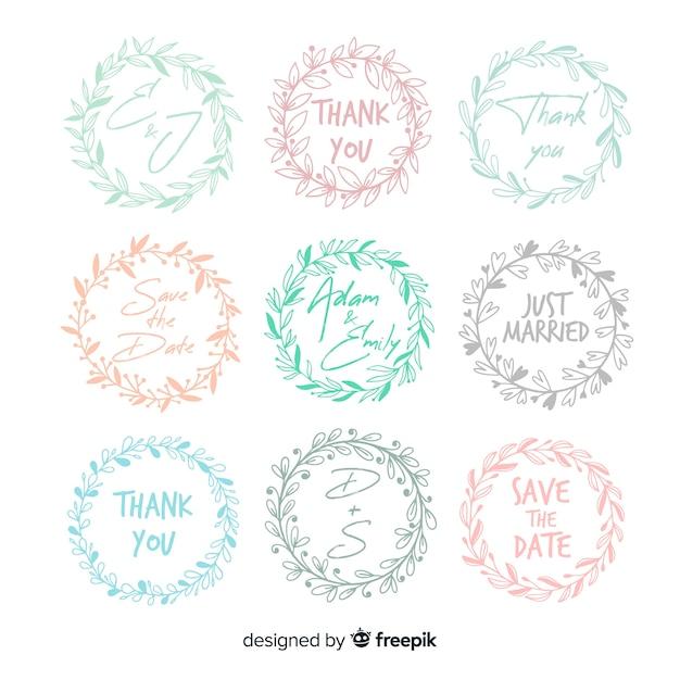 Emblemas de casamento floral mão desenhada Vetor grátis