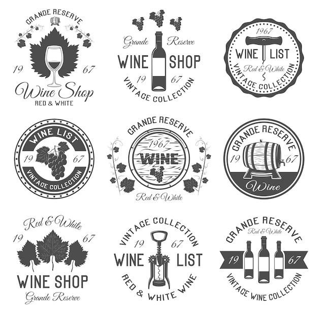 Emblemas de vinho preto branco com folhas e cachos de uvas Vetor Premium
