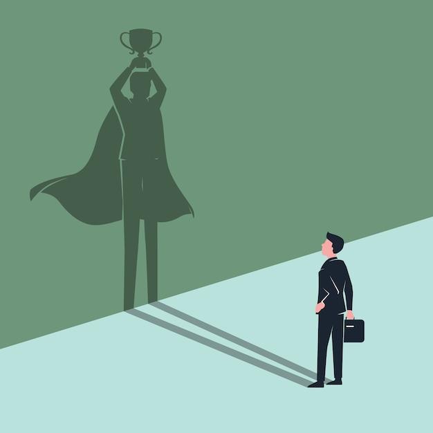 Empregado empresário se vê sombra como vencedor super-herói Vetor Premium