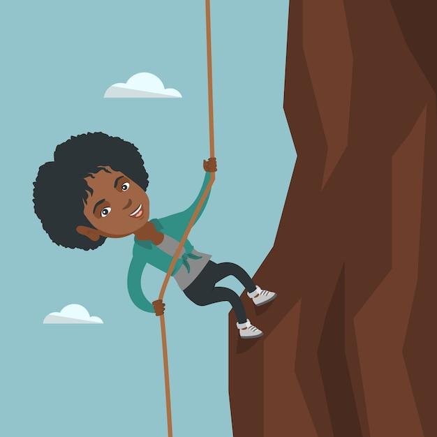Empresária africana subindo a montanha. Vetor Premium