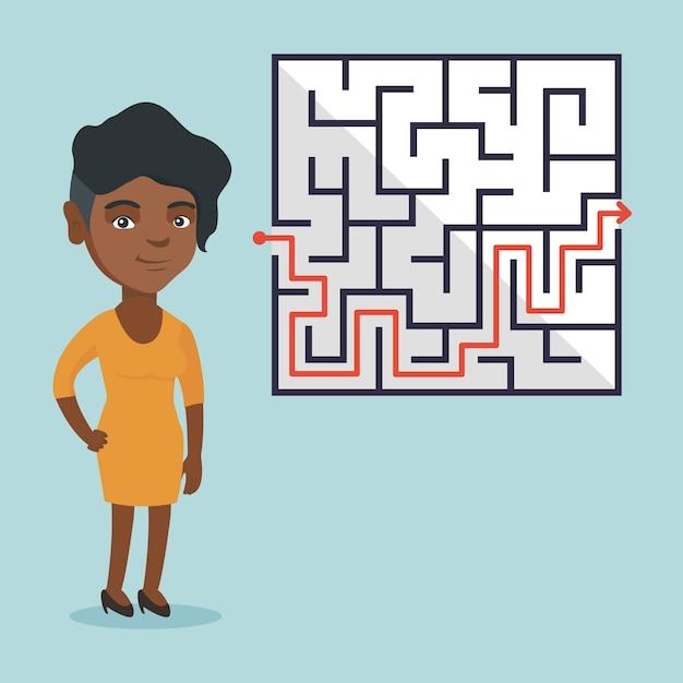 Empresária olhando labirinto com solução. Vetor Premium