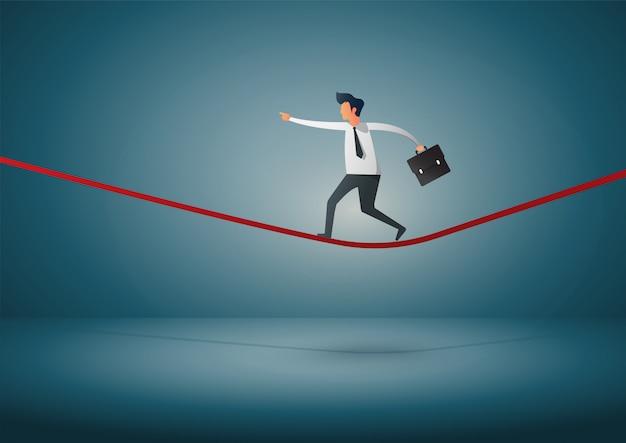 Empresário andando em uma corda. Vetor Premium