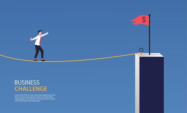 Empresário andando na corda para o símbolo da bandeira vermelha. desafio de negócios Vetor Premium