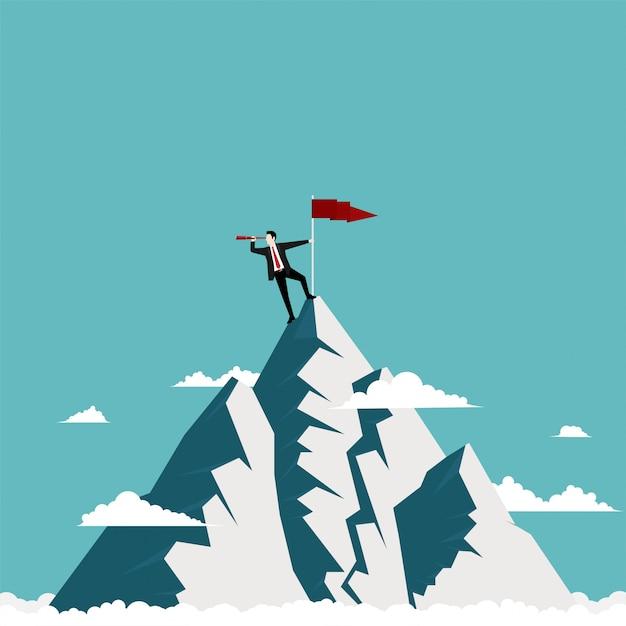 Empresário de pé no topo da montanha Vetor Premium