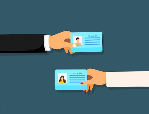 Empresário dos desenhos animados mão segurando o cartão de identificação. Vetor Premium