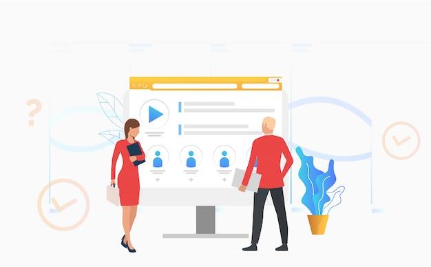 Empresário e mulher de negócios olhando para monitor de computador Vetor grátis
