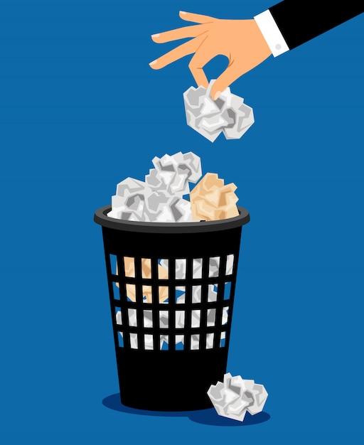 Empresário mão colocar papel no lixo Vetor Premium