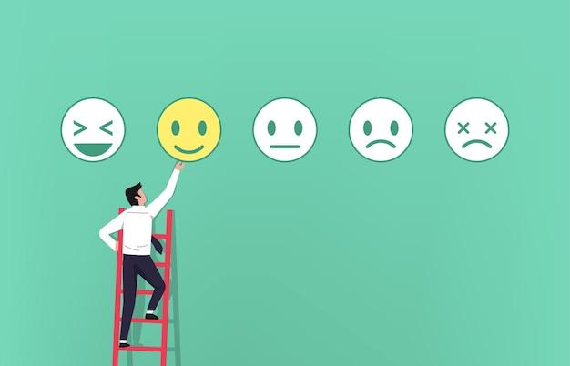 Empresário na escada dando feedback com o conceito de símbolo de emoticons Vetor Premium
