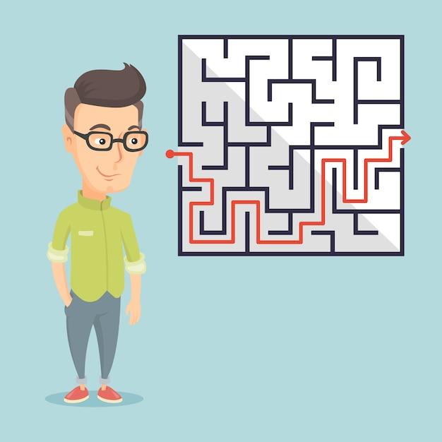 Empresário, olhando para o labirinto com solução. Vetor Premium