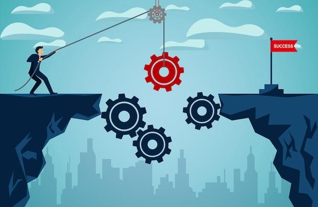 Empresário que puxa a engrenagem vermelha com a corda para ser uma ponte leva à bandeira vermelha objetivo Vetor Premium